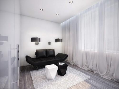 Комната отдыха с черным диваном