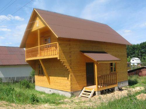 Балкон на деревянных консолях