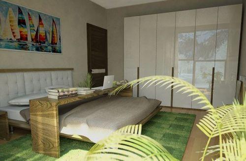 Зеленый ковер в спальни