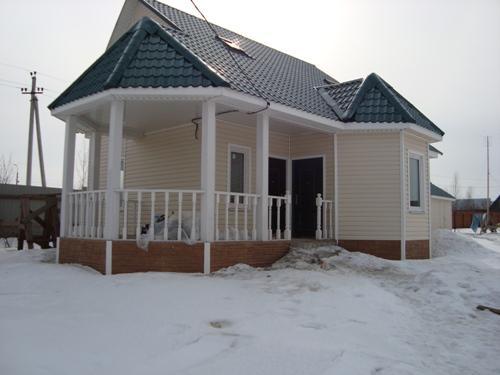 фото дома отделанного сайдингом