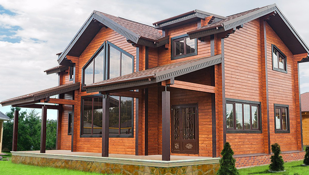 Чем покрасить фасад деревянного дома?